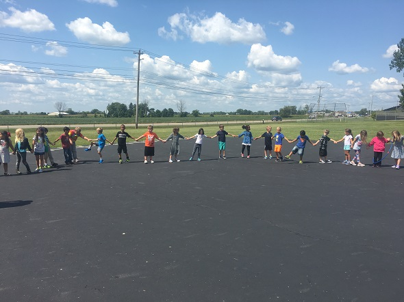 1st grade students playing outside
