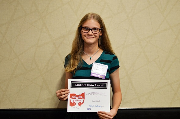 student Leah Shadle with her award
