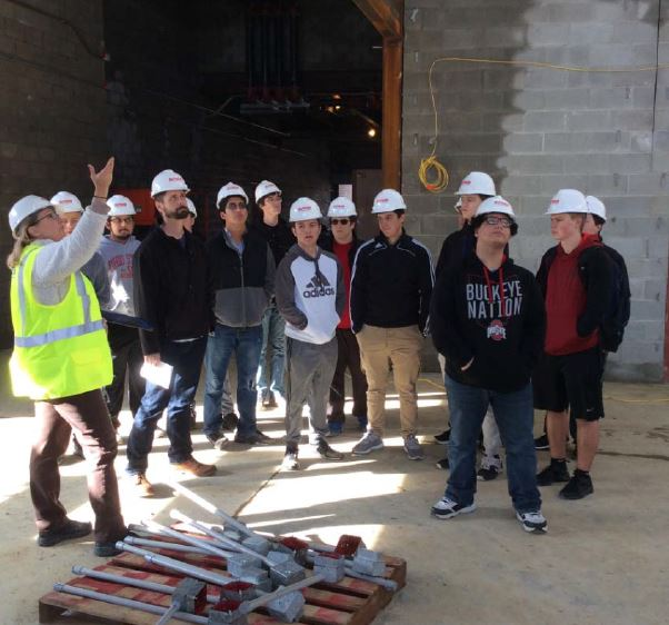 students touring new memorial building