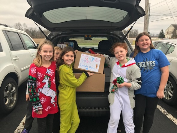 students delivering the toys